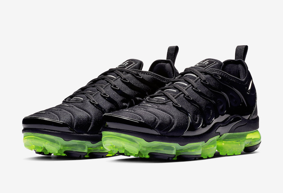 214b4b3431ffe This Nike Air VaporMax Plus Is Dripping In Black And Volt